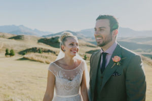 backlit couple laughing in hills