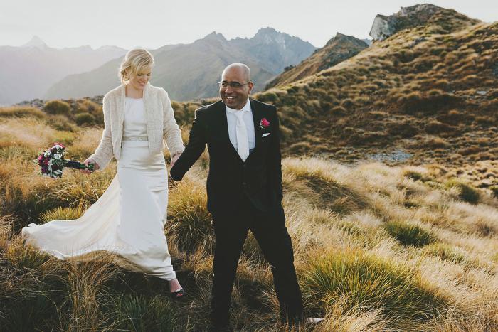 Bride and Groom walking on mountaintop, Natural, Mt Aspiring Wedding, New Zealand, Wanaka
