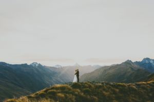 couple on mountain top mt aspiring