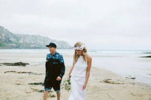 bride and groom walking Caitlins beach