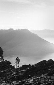 bride and groom walking mountaintop