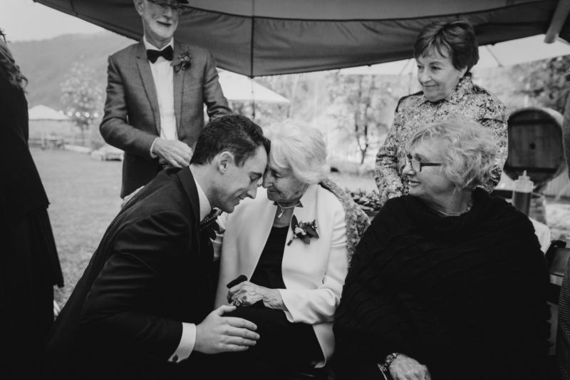 groom having special moment with grandmother