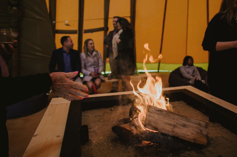an open fire in the tipi
