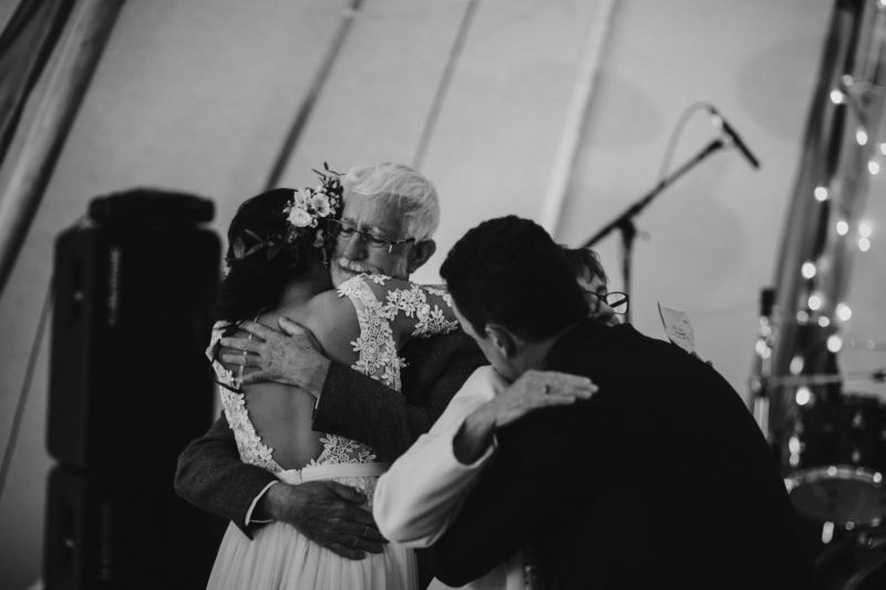 bride and groom hug parents