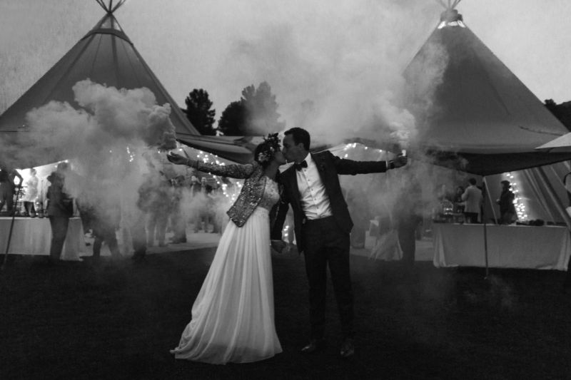 bride and groom with smoke bombs