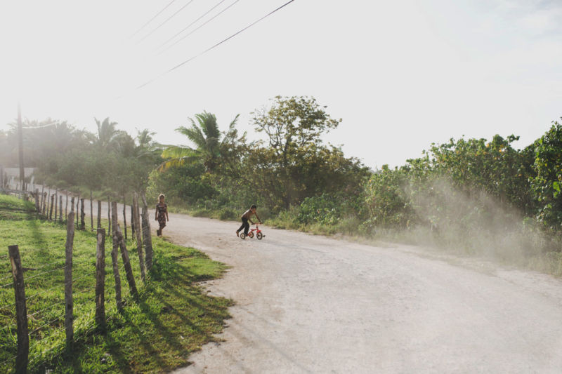 kids playing on dusty road vava'u