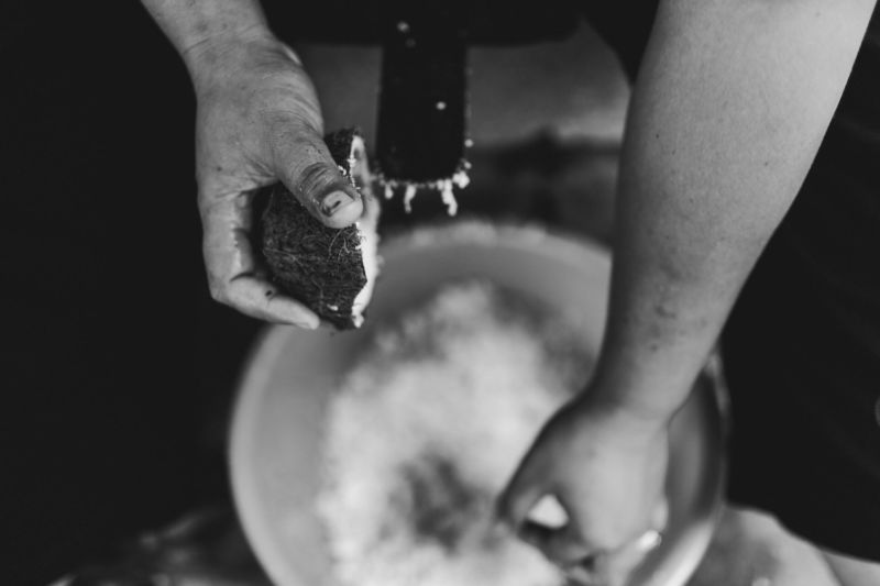 close up of hands making coconut milk