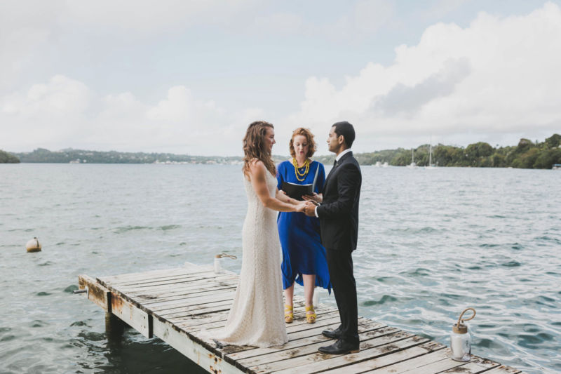 bride and groom on wharf during ceremony