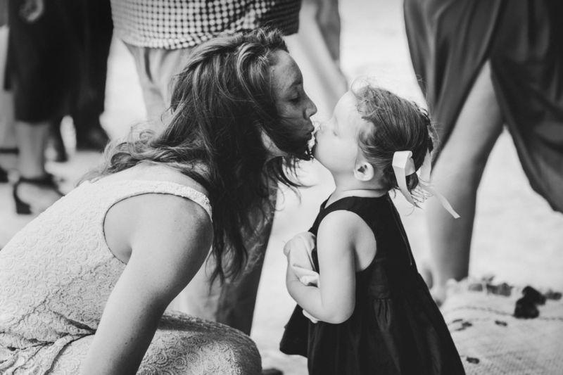 bride kissing flowergirl on lips
