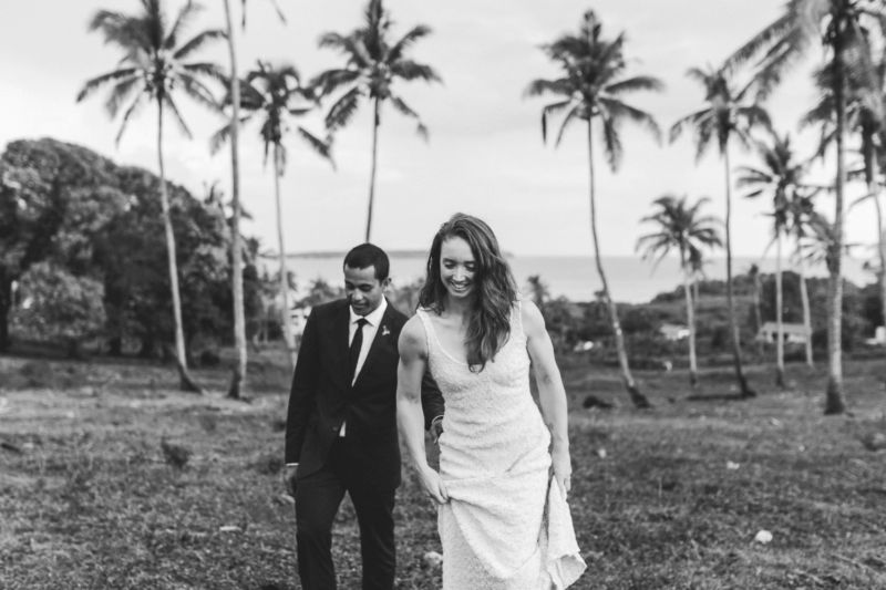 bride and groom walking in plantation