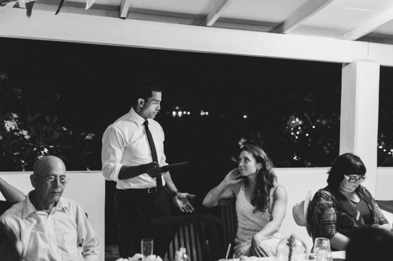 groom speaking to bride during speech