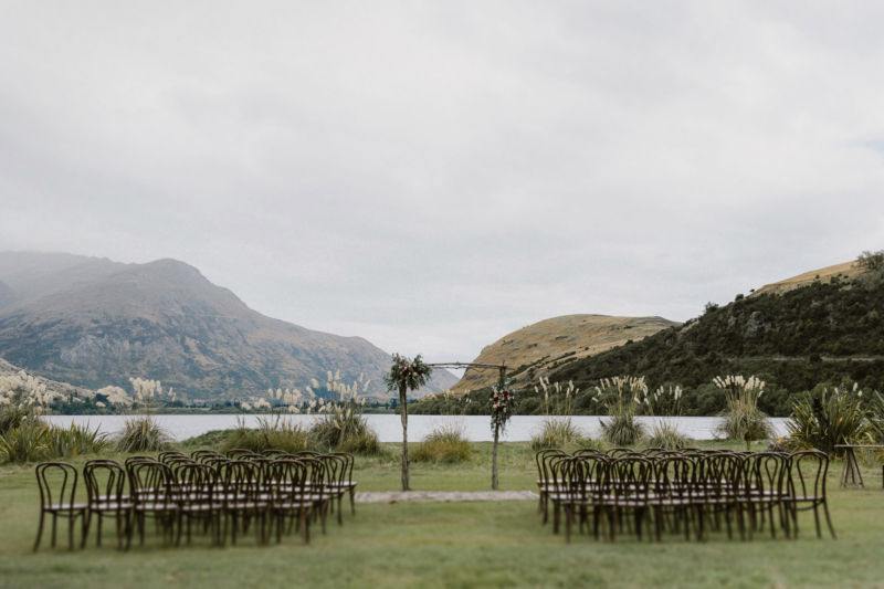 wide shot of ceremony arch and chair set up