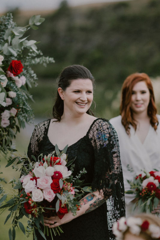 relaxed portrait of brides face watching her bride arrive