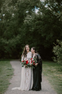 bridal portrait on a path with trees in background laughing
