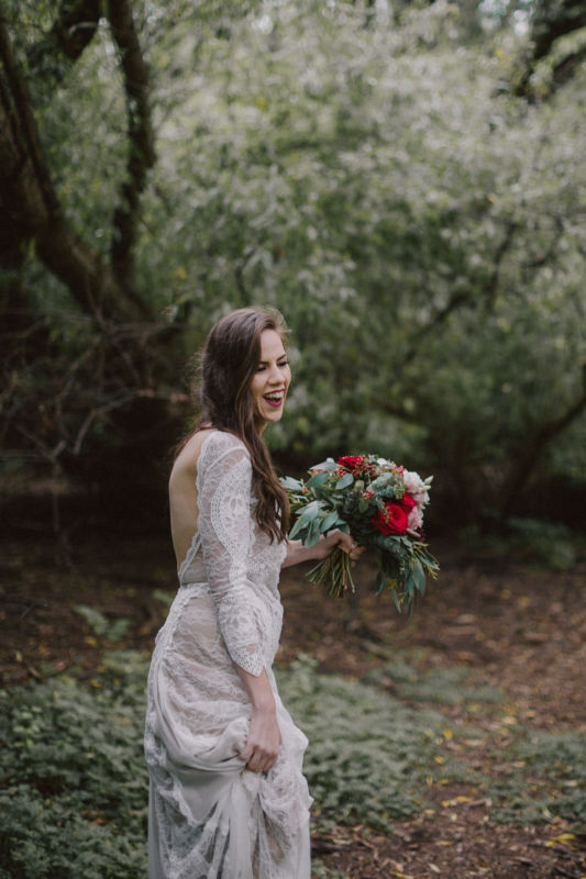 candid of bride in forest