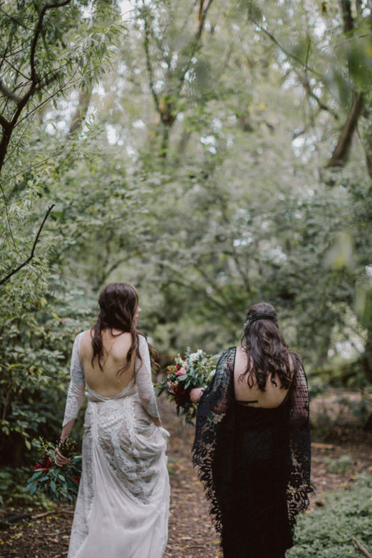 brides walking away in forest