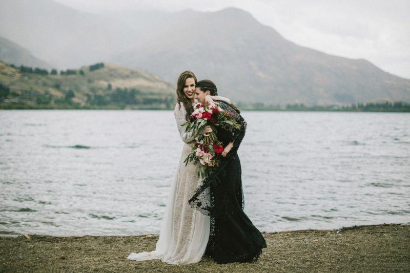 brides embracing and having fun