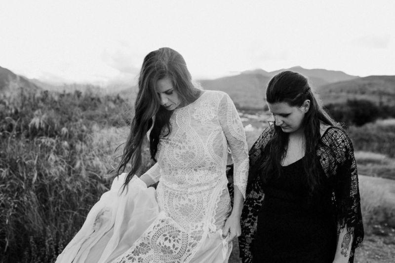 candid b&w of brides walking towards camera