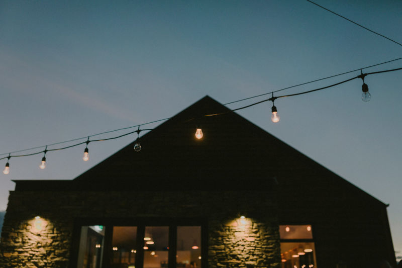 outside of building at twilight with festoon lights