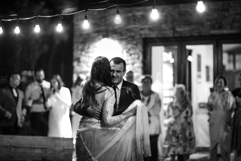 b&w of bride dancing with her dad outside under lights