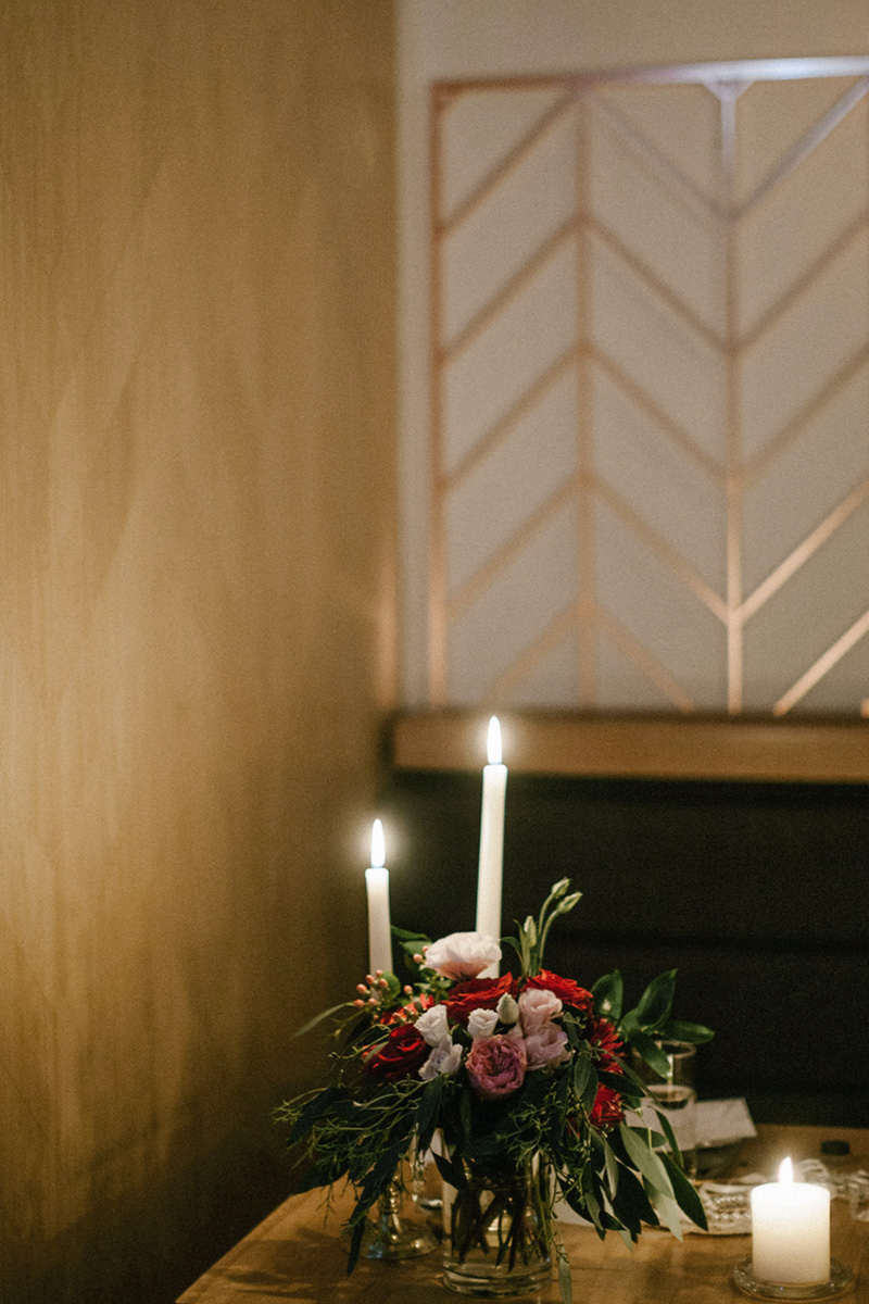 candle light and flowers on table