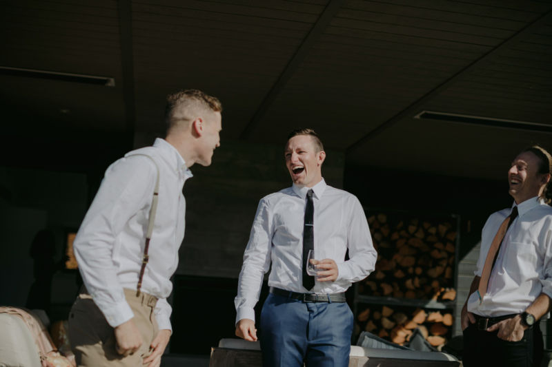 groom laughing out loud with groomsmen
