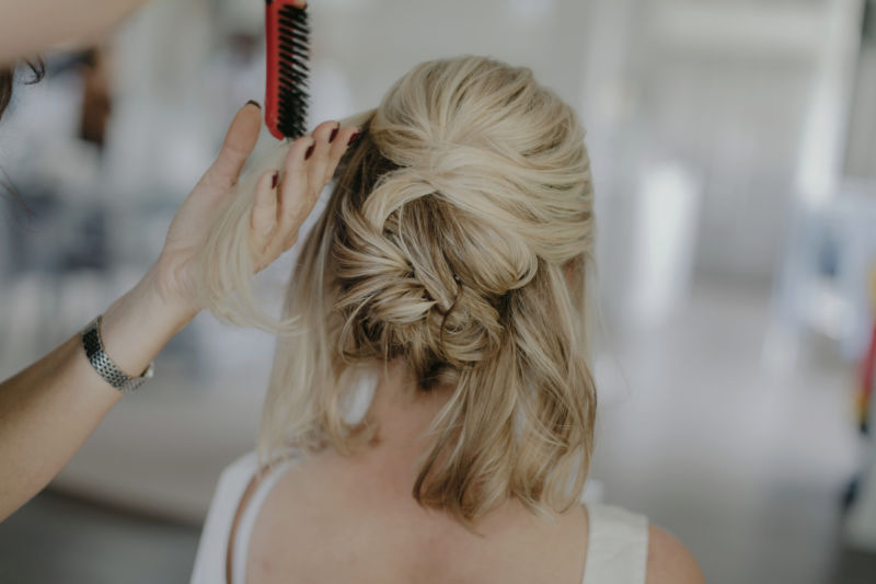 close up of bride having hair done