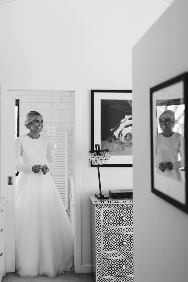 bride appearing from bathroom