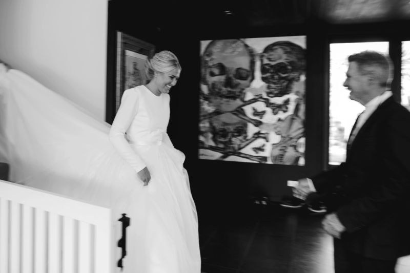 bride descending the stairs to greet her awaiting father