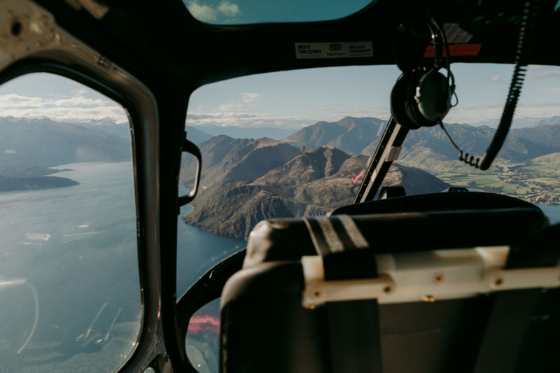 view of wanaka out of helicopter window