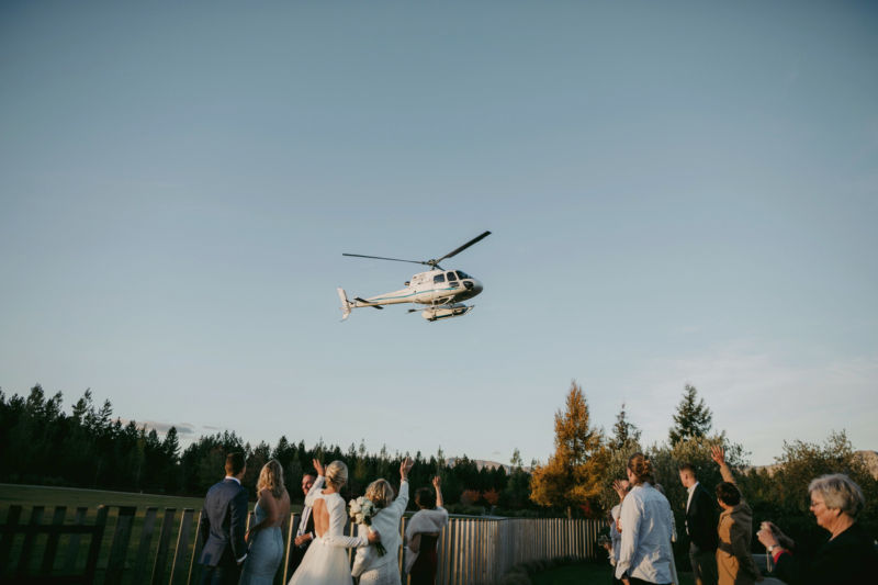 guests waving to helicopter as it leaves