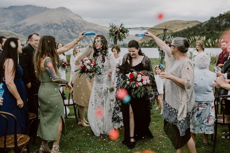 brides being showered with confetti after ceremony queenstown