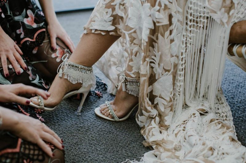 close up of brides shoes