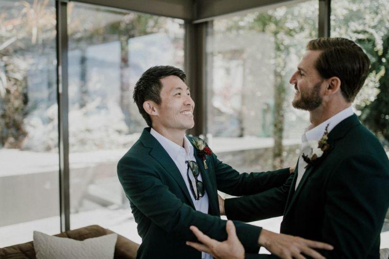groomsen embracing groom
