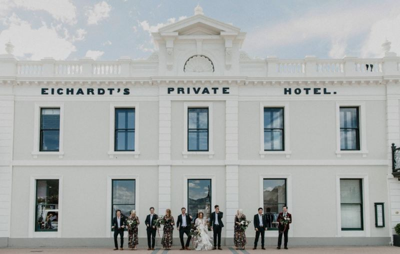 bridal party in front of eichardts private hotel