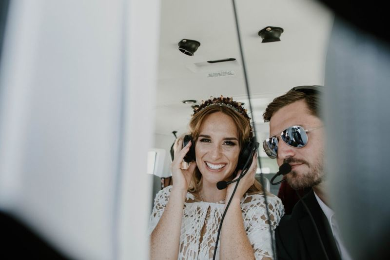 bride and groom in helicopter with head sets on