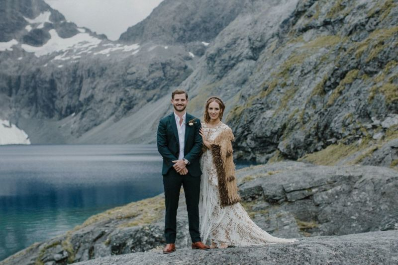 portrait of bride and groom in front of lake