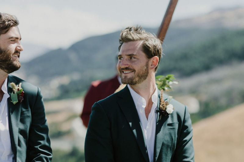 groom smiling at groomsmen