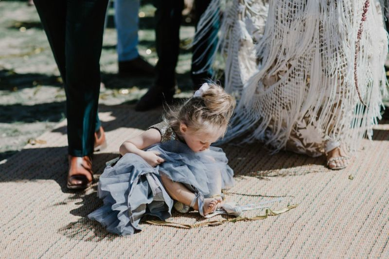 flowergirl sitting down in aisle