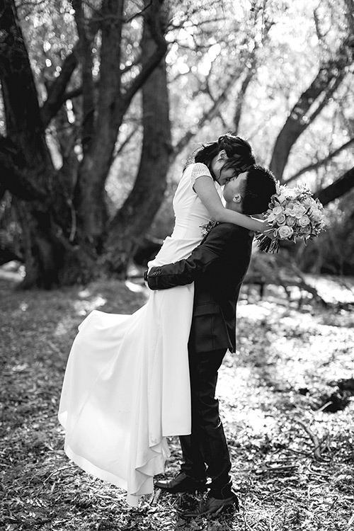 Bride and groom kissing - Queenstown wedding photographer